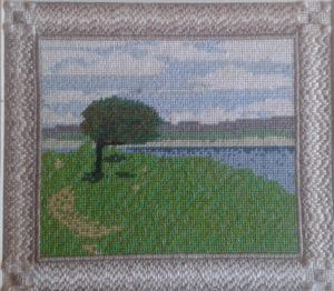 This is a picture of Kenfig Pool worked in Needlepoint
